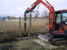 Installation of environmentally friendly helical Walkway Piers